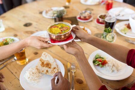 international friends eating at restaurant