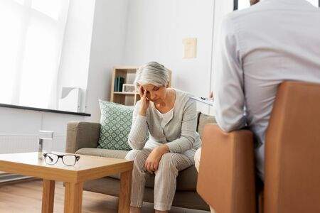 sad senior woman patient and psychologist Stock Photo
