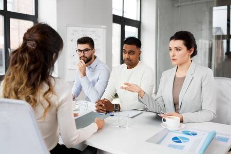 new job, hiring and employment concept - international team of recruiters having interview with female employee at office Stock Photo - 126313179