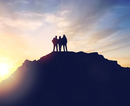 group of travelers with backpacks over sunrise Stock Photo