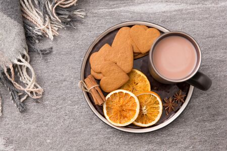 hot chocolate with dried orange, cookies and anise