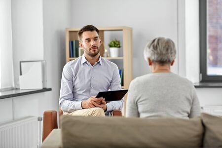 psychologist listening to senior woman patient Stock Photo