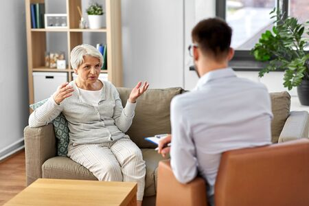 senior woman patient and psychologist