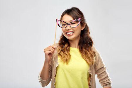 happy asian woman with big party glasses Banco de Imagens
