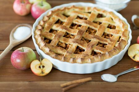 Close up of apple pie on wooden table