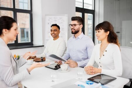 New job, hiring and employment concept - International team of recruiters having interview with female employee at office Stock Photo - 126774801