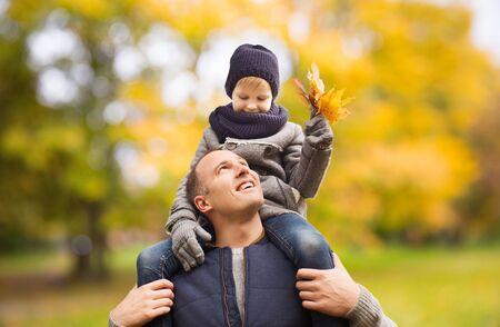 Happy family having fun in autumn park