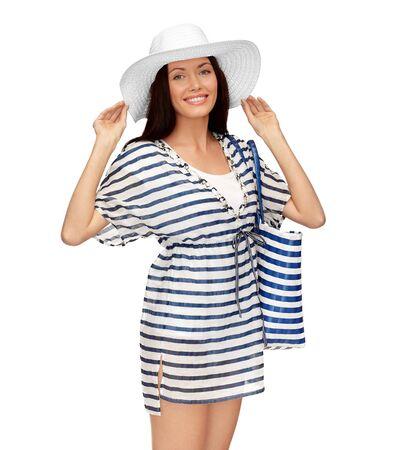 young woman in striped tunic and sun hat