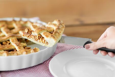 close up of hand with piece of apple pie on knife Reklamní fotografie