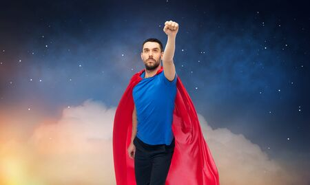 man in red superhero cape over night sky Imagens