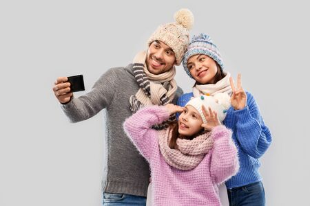 happy family taking selfie by smartphone