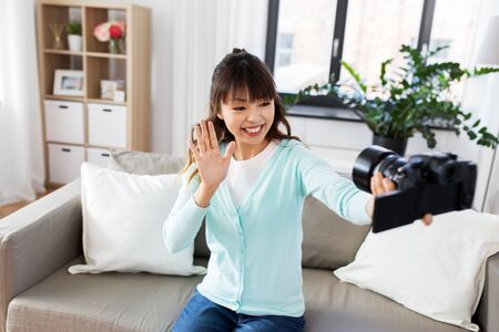 asian female blogger with camera recording video Banco de Imagens