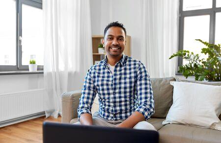 Indian male blogger video blogging at home Banco de Imagens