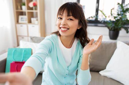 Asian female blogger taking video or selfie