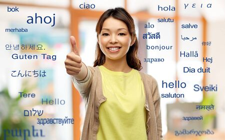 happy asian woman showing thumbs up Banco de Imagens - 127629967