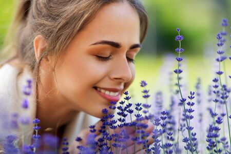 Close up of woman smelling lavender flowers 스톡 콘텐츠