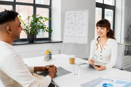 employer having interview with employee at office Stock Photo - 127780677