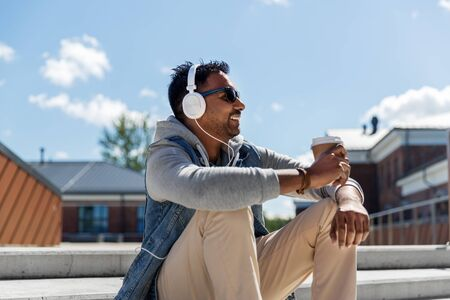 man in headphones listening to music on roof top