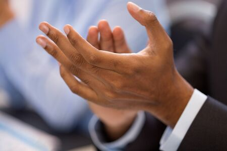 hands of businessman applauding at conference Stock Photo