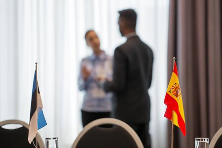 flags in boardroom at international conference