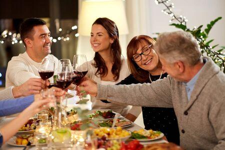 happy family having dinner party at home Фото со стока