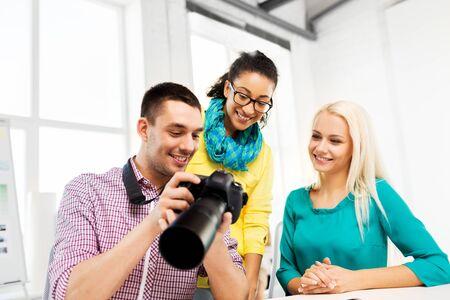 photographers with camera at photo studio 版權商用圖片