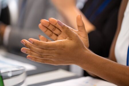 hands of businesswoman applauding at conference