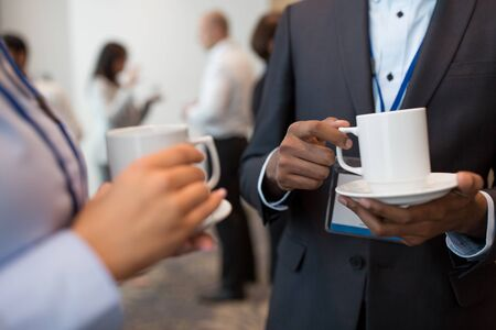 business people with conference badges and coffee