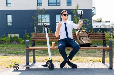 businessman recording video blog by smartphone