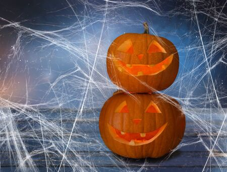 two pumpkins or jack o lanterns and spiderweb Stock fotó