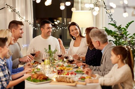 happy family having dinner party at home Standard-Bild