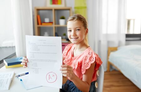 student girl with school test good mark at home Zdjęcie Seryjne