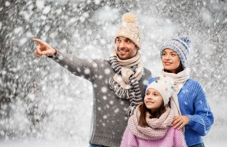 happy family in winter clothes on snow background