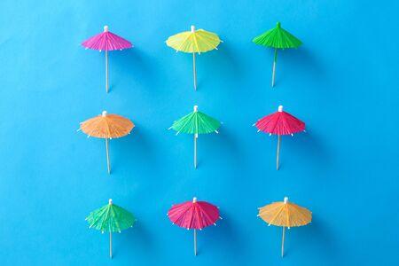 cocktail umbrellas on blue background Banco de Imagens