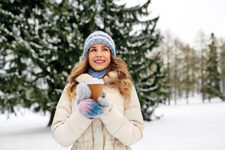 happy woman drinking coffee outdoors in winter Stock Photo