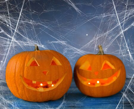 two pumpkins or jack o lanterns and spiderweb Stock Photo
