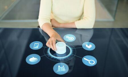 woman with control knob on interactive panel Stockfoto
