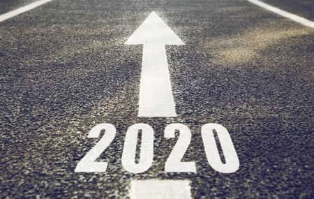 white road marking in form of 2020 year and arrow 版權商用圖片
