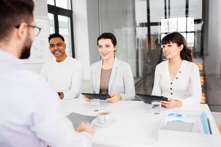 recruiters having job interview with employee Stock Photo - 129601898