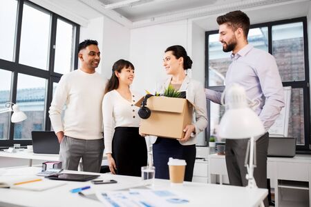 new female employee meeting colleagues at office Stock Photo
