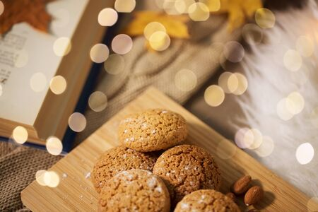 oatmeal cookies on wooden board at home