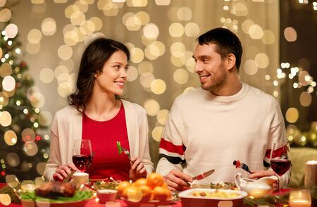 Happy  couple having christmas dinner at home