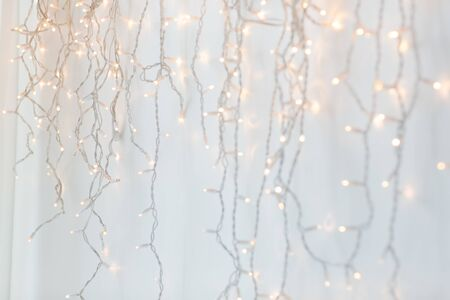 christmas garland lights over grey background