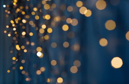 christmas garland lights over dark blue background