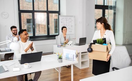 business, job and quit concept - happy smiling colleagues applauding to female office worker