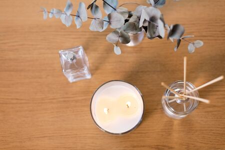 aroma reed diffuser, burning candle and perfume