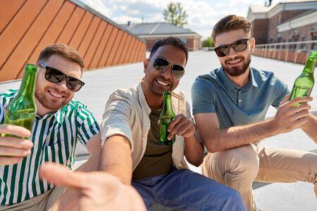 men drinking beer and taking selfie on street Stock fotó