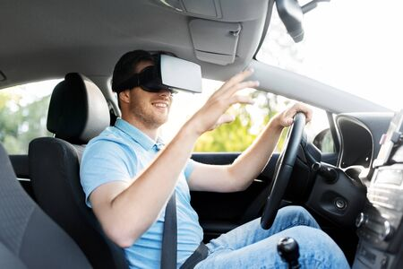 virtual reality, technology and driving concept - smiling man or driver wearing vr glasses in car
