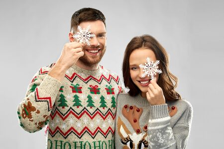 happy couple at christmas sweater party Stockfoto - 130613261
