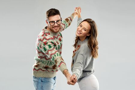 couple dancing at christmas ugly sweaters party